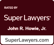 Dark red badge that says John R. Howie, Jr. has been rated by Super Lawyers